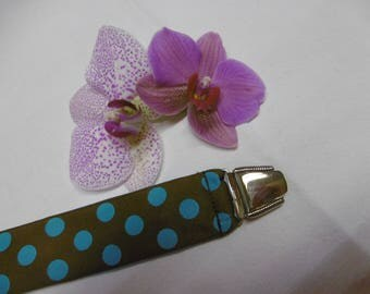 Brown background and turquoise polka dots textile pacifier
