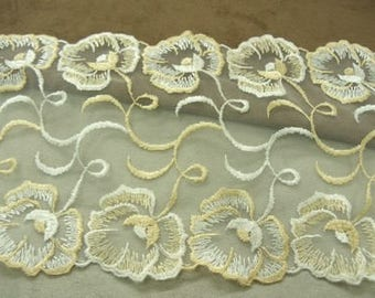 White embroidery - 15 cm - on on beige background