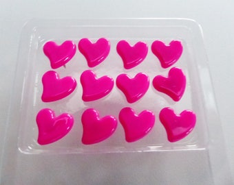 12 push pins in dark pink heart