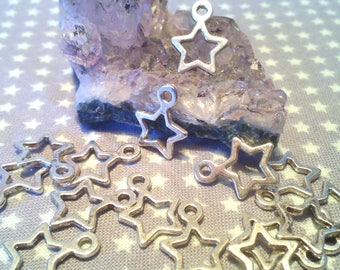 Set of 20 pendants silver perforated stars 14 * 10 1.5 mm hole