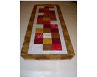 table runner in Christmas colors patchwork fabric