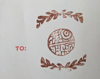 Linocut sticker of a Laurel wrapped Death star (1of1)