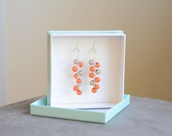 Orange and blue round beads earrings