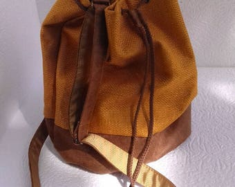 bucket imitation distressed leather and mustard yellow woven bag