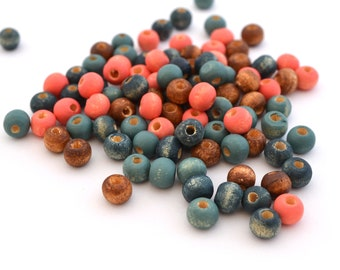 100 round dark blue wood beads, pink coral and Brown 6mm