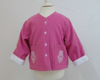 Embroidered fuchsia fleece lined white jacket