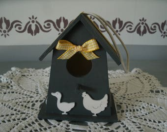 small decorative birdhouse, yellow and natural