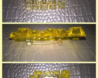 Yellow resin brooch