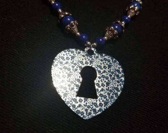 Blue necklace with floral heart shaped lock charm