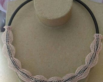 Crew neck, handmade crocheted copper wire with a black leather cord. Pattern bead