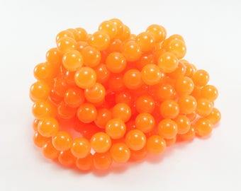 Neon Orange glass beads 20 +/-8mm for creations