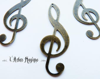 bronze 10 fancy treble clef pendant 19 x 53 mm