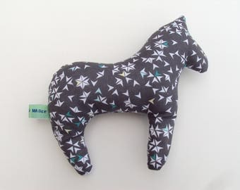 Cushion or blanket in the shape of a horse
