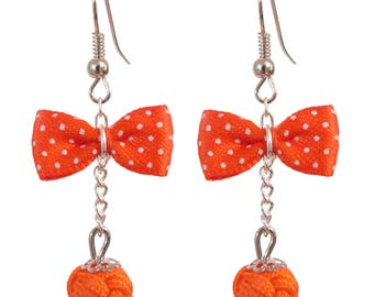 Bow tie Orange retro inspired earrings with white dots