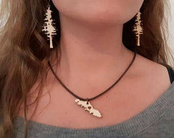 Natural Pacific Coast-themed laser cut jewelry in wood and acrylic