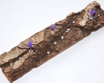 Bark of oak, beads and blue flowers