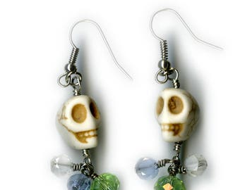 Howlite skull earrings with green blue and clear beads