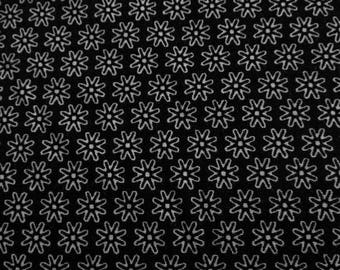 Printed cotton fabric patterns flowers 1 cm on a black background