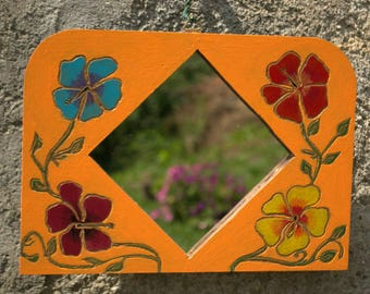 Wall mirror with carved wooden hibiscus