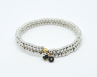 Silver colour bead, memory wire bangle bracelet with two coils and a black spinel charm on each end