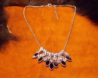 Necklace with smokey quartz and rhinestones mounted in gold plated mounting