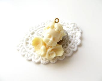 Off-white resin Cherub charm pendant