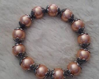 Handmade womens peachy pink pearl beaded bracelet
