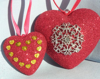 Glitter hearts in red and gold.