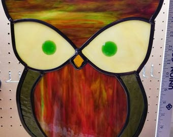 Owl - Stained glass sun catcher.  Measures 10 in × 12 in and includes 24 inches of black chain to hang.