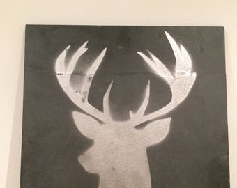 Silver stag on slate