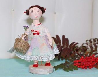 Doll/Girl with a basket
