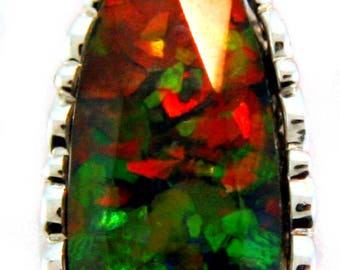 Long Oval Shaped  Canadian AAA Quality Ammolite Pendant set in Filigree Design Sterling Silver.