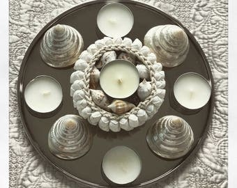 Set of candles, seashells and candle holder