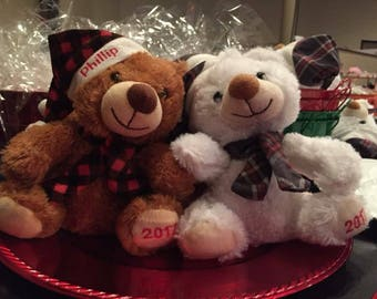 Personalized teddy bear. You chose a color, year is on bear foot and name goes on his hat