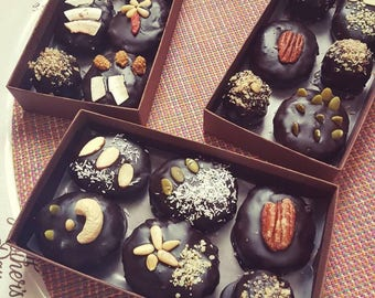 6 Vegan Date balls covered in carob chocolate, healthy treats, Valentine's Day  sweets with walnuts
