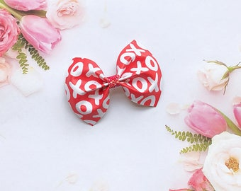 Xoxo hair bow, faux leather bow, Valentine's Day bow
