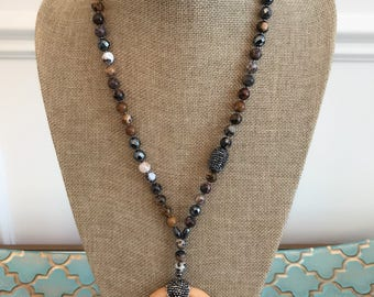 Faceted agate, pyrite and pave beaded necklace with encrusted horn pendant