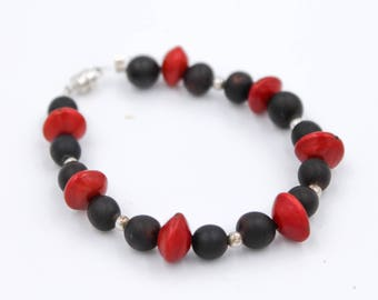 Bracelet red seeds and Canna