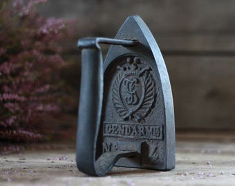Antique iron 19th. Cast iron with initials. Vintage cast iron. Antique letters press. French bookends. Doorstop. Laundry room. Sad iron.