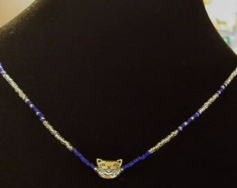 Beaded necklace with silver cat charm