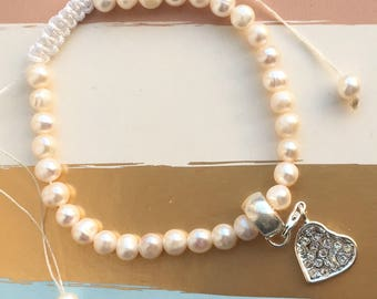 Pearl look bead bracelet with heart charm