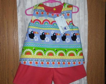 Girls 3T top and short set. Top is reversible with snap back. Red shorts with elastic waist  20.50 inch.