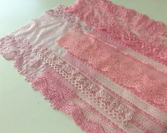 assortment of various smaller sheer lingerie tulle lace / mesh swatches — baby pink — different sizes and patterns