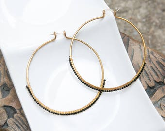 Hand hammered bronze hoops with black beading and sterling silver earwires