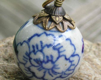 Vintage Asian porcelain pendant accented with vintage brass..big and impressive.