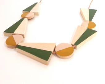 Glide natural wood statement necklace - hand painted fern green and ochre limited edition circle modern