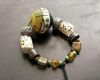Lampwork glass bead set handmade by Lori Lochner rustic blown glass amber black and ivory tribal boho artisan jewelry supply sra