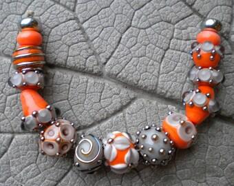 mango mist lampwork beads by cherie sra r114 flameworked glass bead orange coral gray lampwork bead
