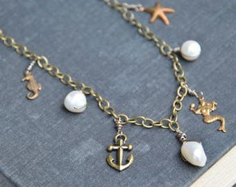 By the Sea. Brass and freshwater pearl ocean themed charm necklace