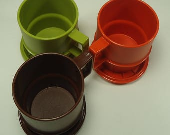 Set Of Three Stackable Mugs With Lids From Tupperware Orange, Green, And Brown